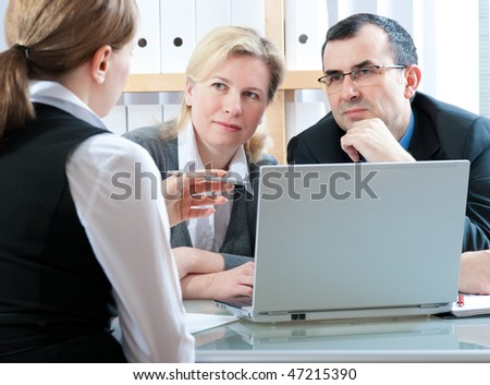 mid adult couple meeting with agent or advisor - stock photo