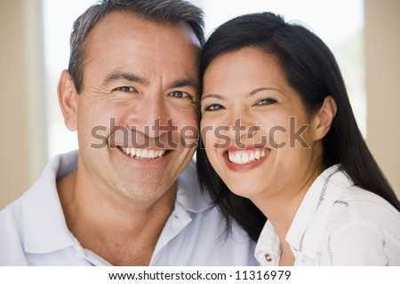 Mid-adult couple smiling at camera - stock photo