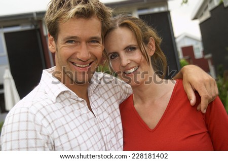 Mid adult couple standing in garden - stock photo