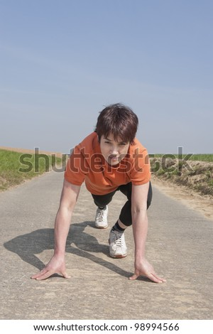 Mid adult jogging woman ready to run - stock photo