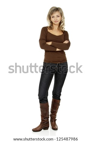 mid adult smiling woman portrait, attractive caucasian middle 40 years old woman in brown sweater, jeans and high boots over white