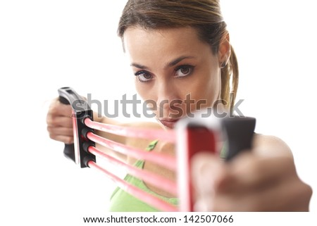 mid adult woman doing fitness exercise and training muscles with rubber band on white background - stock photo