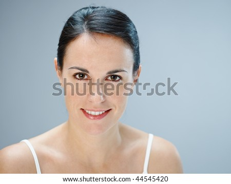 mid adult woman looking at camera. Copy space - stock photo