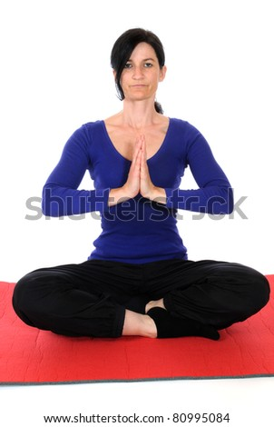 Mid adult woman practicing yoga exercises - stock photo