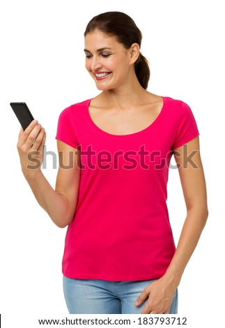 Mid adult woman reading text message on smart phone against white background. Vertical shot. - stock photo