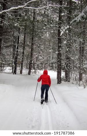 Mid adult woman skiing, Orangeville, Dufferin County, Ontario, Canada - stock photo