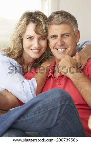Mid age couple at home - stock photo