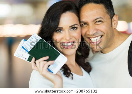 mid age husband and wife travelling by air - stock photo