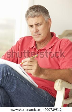 Mid age man sketching - stock photo