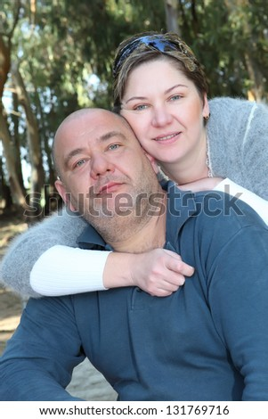 mid aged  couple portrait in the park