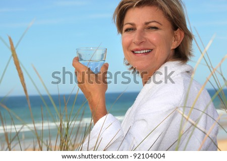 mid aged woman relaxing on the beach - stock photo