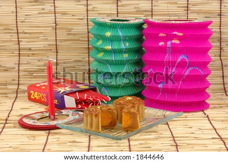 Mid-autumn festival: mooncake, chinese lanterns and candles - stock photo