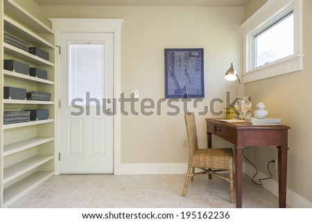 Mid Century home office interior with furniture and tiled floor - stock photo