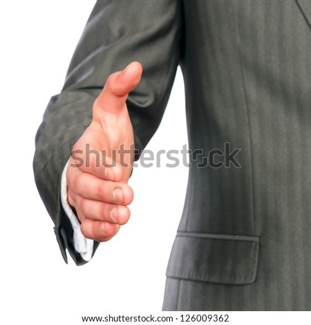 Mid section of a business man offering handshake isolated on white