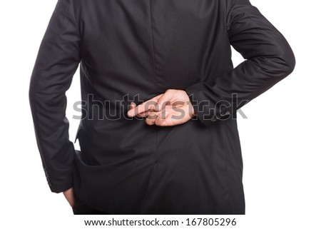 Mid section of a businessman with crossed fingers over white background - stock photo