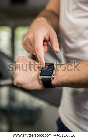 Mid section of man using smart watch