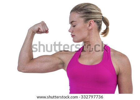 MId section of muscular woman flexing muscle on white background