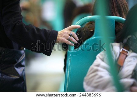 Mid section of the passenger holding the handrail - stock photo