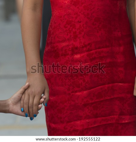 Mid section view of a woman holding hand of her child, Changping District, Beijing, China - stock photo