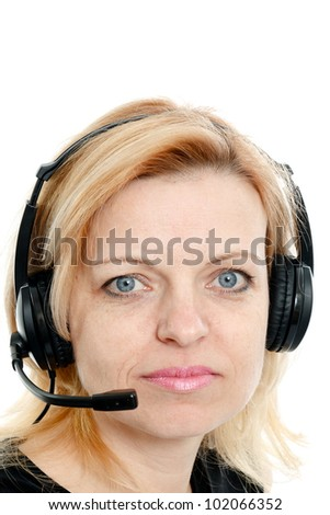 Mid-year woman with headphones and a microphone on a white background - stock photo