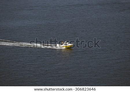 MIDDELFART, DENMARK â?? AUGUST, 13: A speed boat tour on Little Belt close to The Old Little Belt Bridge,  13th August 2015. - stock photo