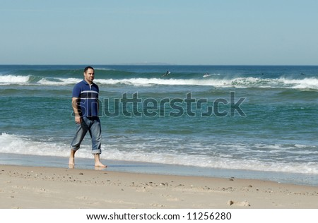middle age caucasion men walking near the water on the beach