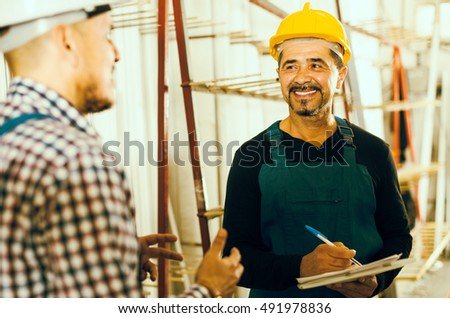 Middle age engineer offering contract to employee