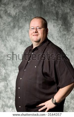 middle-age man against portrait backdrop - stock photo