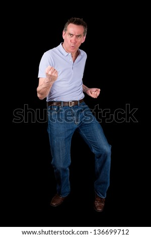 Middle Age Man Doing Funny Dance Pose Black Background - stock photo