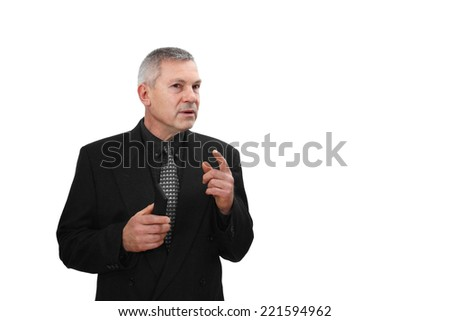 Middle age man in business black suit holds mobile phone in hand and speaks gesturing isolated on white background with copy space - stock photo