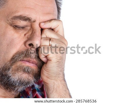 Middle age man suffering from a headache. Isolated on white with copy-space