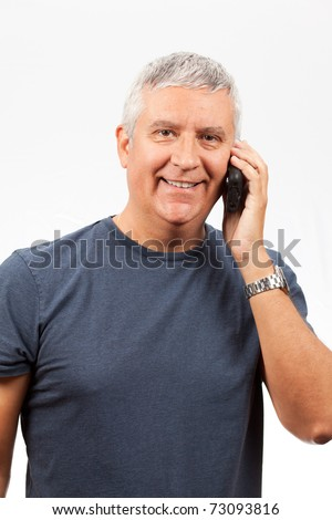 Middle age man with gray hair talking on a cell phone with a white background. - stock photo