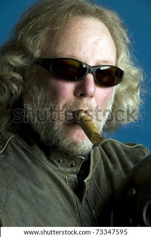 middle age senior long hair wearing leather jacket smoking expensive cigar - stock photo