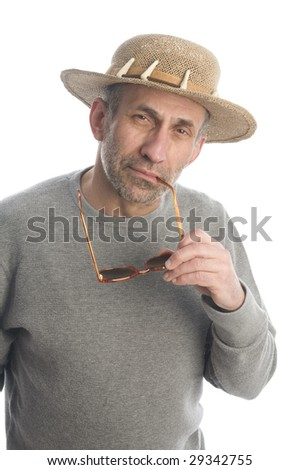 middle age senior man baby boomer wearing straw hat with quizzical expression look on face