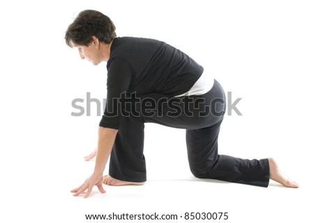 middle age senior woman demonstrating yoga position Anjaneyasana Kneeling quadriceps Lunge & Hamstring Stretch