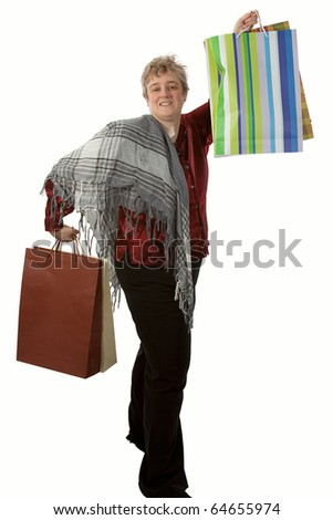 Middle age short hair blond woman holding several shopping bags - stock photo