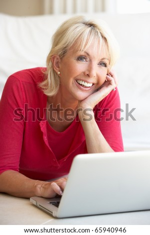 Middle age woman on her laptop computer