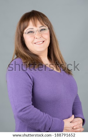 Middle age woman posing with glasses, xxl overweight - stock photo