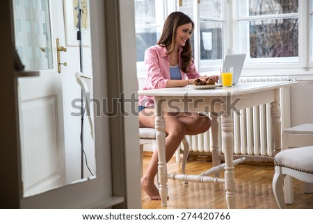 Middle age woman working on her blog - stock photo