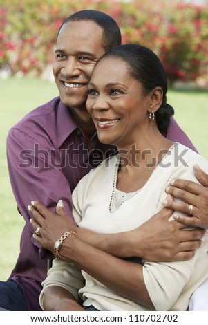 Middle aged African American man embracing his wife