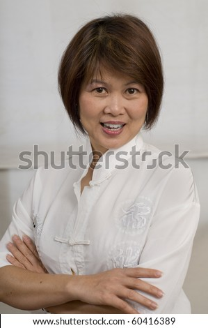 Middle aged Asian woman smiling - stock photo