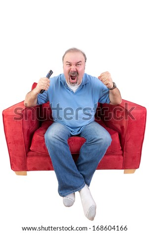 Middle-aged bearded man screaming at the television in anger or as he cheers on his favourite sports team while holding the remote control in his hand , isolated on white - stock photo