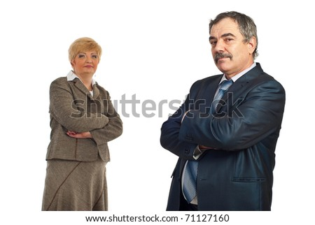 Middle aged business man with arms folded smiling in front of camera and his colleague woman standing in background - stock photo