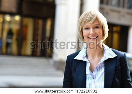 Middle aged business professional, outdoors - stock photo