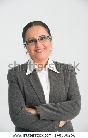 Middle aged business woman with crossed arms and warm smile - stock photo