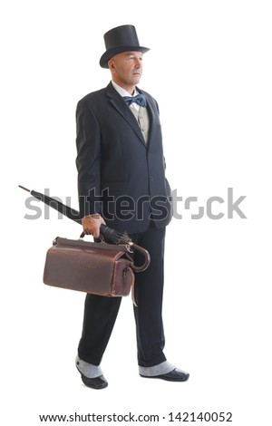 Middle aged  businessman in a retro business suit with valise and umbrella isolated on white - stock photo