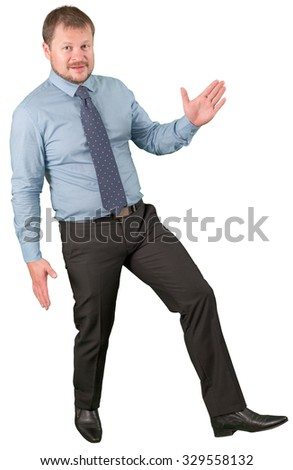 Middle-aged businessman moving on white background - stock photo