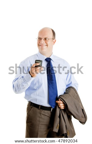 Middle-aged businessman sending a text message and smilling, isolated on white background - stock photo