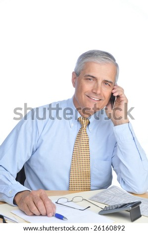 Middle Aged Businessman Sitting at Desk Talking on Cell Phone