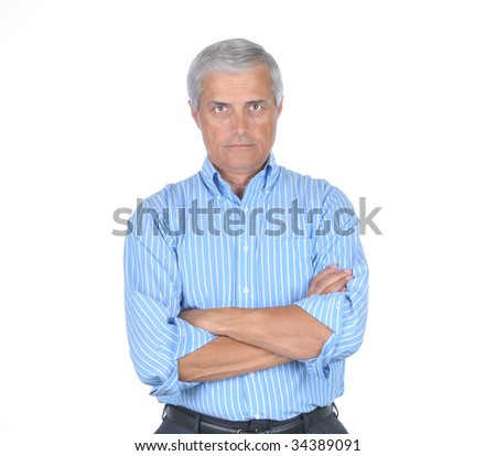 Middle Aged Businessman with arms folded with stern expression on his face isolated on white - stock photo